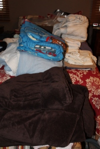 The pile of stuff I pulled out of our closets.